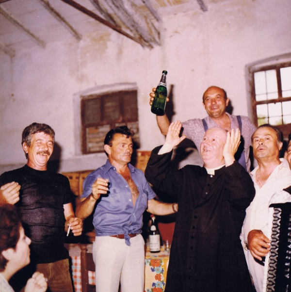 Historical photo of the day: priest having fun with locals in Casale Monticchio.