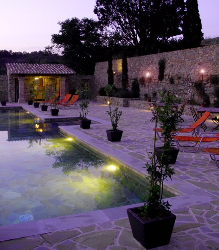Swimming pool and terrace by night