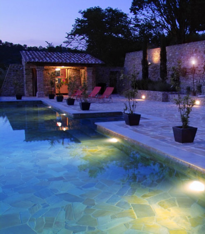 Terrace and swimming pool by night